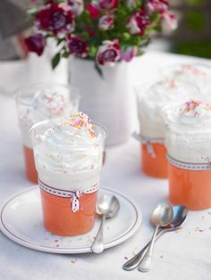 Rhubarb and custard jellies in reusable plastic tumblers