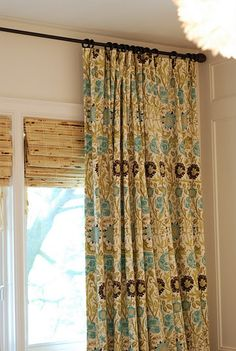 Window treatment and mounting height of rod.  Love the print w/ bamboo shade.