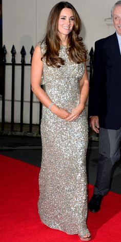 SEPTEMBER 12, 2013 Catherine made her first official appearance after giving birth to Prince George at the Inaugural Tusk Awards gala at The Royal Society in London. The Duchess stepped out in style wearing a stunning floor-length Jenny Packham pale gold sequin gown with her Jimmy Choo sandals.