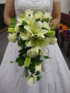 Cascade bridal bouquet of ivory roses and lilies