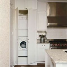 Right now we have the refrigerator in a room off of the kitchen with the washer and dryer. I like having the W/D in the kitchen but not the awkward placement. Stacking them may solve some issues.