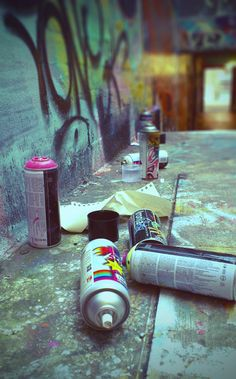 But then I look really closely at those words, and I realize that they aren't what was originally written there at all. I realize that those words are graffiti, scrawled in black over the gold inscriptions carved into the walls. Street Art Graffiti, Spider Man Comics, Guzma Pokemon, Arte Banksy, Photographie Street Art, Delsin Rowe, The Get Down, Spray Paint Cans, Spray Painting