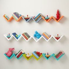 Origami Wall Shelf | The Land of Nod Display three shelves one in orange, grey, and aqua.