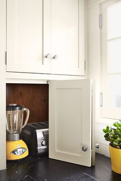 A hidden cubby keeps small appliances close at hand but out of sight when not in use.