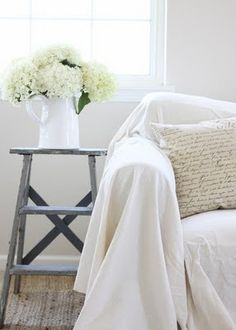 ladder for an end table and pitcher of hydrangeas