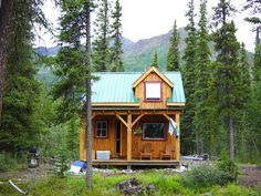 This tiny cabin was actually rather spacious inside, or at least it seemed like it was because it was pretty open. It offered most of the basic amenities…kitchen, stove, bedroom, loft with a futon, kitchen table, and an outhouse off in the forest a bit. - Jeremy's Daily Photograph
