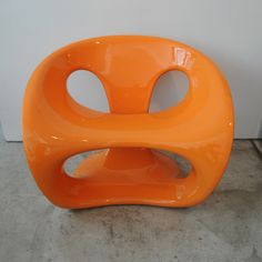 Orange Hara Chair Added almost 2 years ago by adoringlife via Giorgio Guioli  From pioneering Italian furnishings company Kundalini, Hara is a sculptural seat handmade in lacquered fiberglass. It's ideal for outdoor use thanks to a treatment against ultra-violet rays and to the strong resistance of the material to temperature changes. http://fab.com/inspiration/orange-hara-chair