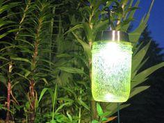DIY Solar Garden Lights: Mason jars, Colored Outdoor Mod Podge and Solar Lights Mason Jar Solar Lights, Solar Path Lights, Solar Lanterns, Solar Lamp, Mason Jar Lighting, Jar Lights, Mason Jar Lamp, Walkway Lights, Garden Lanterns