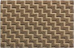 Zerbino in fibra 100% cocco naturale con fondo vinile. Grafica geometrica termo-pressata.