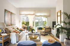 FB 5260a. Salón con salida a terraza, chimenea, sofá, butaca, pufs y color FB 5260a