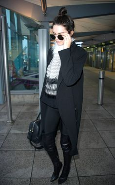 12/06/15 - Kendall Jenner arrives at London Heathrow Airport.