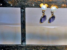 Elegant earrings featuring AAA Perfect White Freshwater Pearls, good luster; and Amethyst glass bezel trillion shape in gold plated frame,