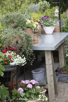 pretty planting table - love the skirt to conceal supplies.
