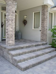 The paver porch complements the brick columns in this entryway.