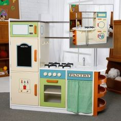 If I were going to buy a play kitchen instead of creating a DIY one, this would be the one I'd buy. Love the laundry center and drop-leaf half table on back!