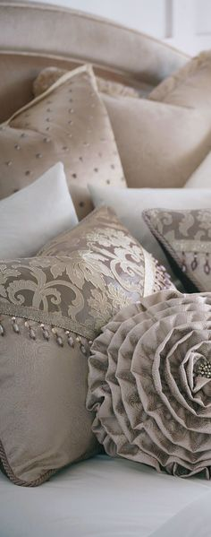 It's all in the details! Cecelia brings grandeur to its light, neutral tones in this glam collection. This decorative pillow is crafted from a jacquard damask ruffled into a layered spiral featuring a jeweled center button. Glittering pearly tones and regal beaded trims make Cecelia fit for a palace. #bedding #luxurybedding #designerbedding #bedroomideas #decoratingideas #masterbedroom #duvetcovers #comforters #luxe #glamorous