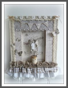 Love this piece - especially the spool, butterflies, wings, banner - not exactly a tutorial but she lists the materials used   ********************************************