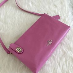 """NWT Coach Pink Crossbody Purse So pretty and classic and perfect for everyday!Silver hardware. Gorgeous pink-blush color. Top of purse features double zipper compartments. One compartment locks with tab and kiss lock. Interior features zipper compartment and side pockets. Measures:10.5""""Wx6.5""""Hx2.5""""D. 24"""" strap drop. No Trades. TB1075. Coach Bags Crossbody Bags"""