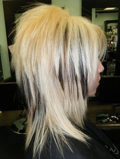 love the cut, not the color.  My hair would never do this....lol at least without hours with a straightener.