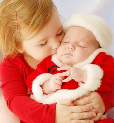One of the most beautiful Christmas pictures I've ever seen!  Sister with her baby brother