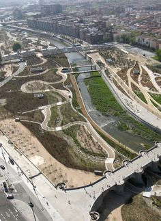 Madrid Rio, Madrid, Spain As to the basic structure of their design, the consortium defined three separate zones: a promenade along the Manzanares, a large park, and a development project to heal the rift in the urban fabric by filling it with a variety of private and public interventions.