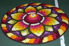 Worlds Largest collection of Pookalams (Flower Carpet): July 2013 Rangoli Designs Flower, Rangoli Designs Diwali, Flower Rangoli, Beautiful Rangoli Designs, Kolam Designs, Onam Pookalam Design, New Year Rangoli, Rangoli Colours, Kerala Tourism