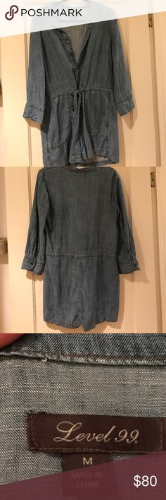Denim Romper Level 99 denim romper purchased from Anthropologie. The romper buttons up from the waist and the waist has an elastic band with a tie. The denim is soft and comfy to wear. Level 99 Other