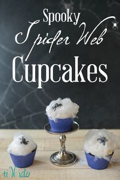 Cupcakes topped with edible cotton candy spider web and gum paste spiders are perfectly creepy for Halloween.
