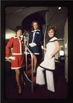 American Airlines Flight Attendants in uniform onboard the Boeing 747 near the spiral staircase to the upper deck