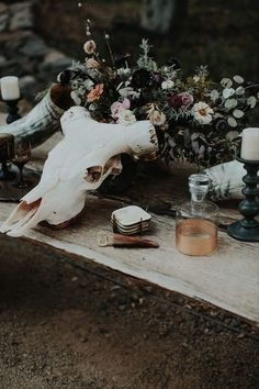 Bring out the mysterious undertones of your moody wedding colors by decorating with collected pieces instead of matchy-matchy decor. Wedding centerpieces with found objects are eclectic and bohemian, tying into the offbeat vibes of a moody palette. - gothic + Halloween wedding inspiration Unique Wedding Centerpieces, Wedding Flower Arrangements, Wedding Reception Decorations, Flower Centerpieces, Wedding Flowers, Wedding Ideas, Wedding Inspiration, Centerpiece Ideas, Decor Wedding