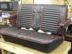 Hot rod seat in black and red. Red and white pinstripe stitching by Nate Van Hofwegen, via Flickr