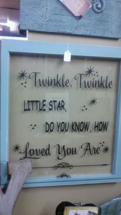 Repurpose an old window--this could be a lovely baby gift.