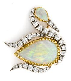 An opal and diamond swan brooch central pear-shaped opal measuring approximately: 19.1 x 11.7 x 3.7mm; estimated total diamond weight: 1.00 carat; mounted in eighteen karat yellow and fourteen karat white gold; length: 1 1/8in.