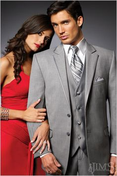 love his grey tux with her red dress