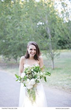 Simple and soft wedding dress with short hair down and white and green bouquet | Photography by Jenni Elizabeth |