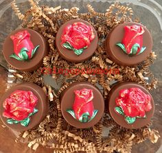 Chocolate covered Oreos with chocolate red and gold glitter roses.
