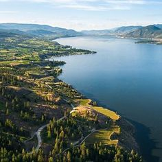 Aerial view of the Naramata Bench and South Okanagan Valley, home to cliff hanging vineyards, hidden river canyons and forested hillsides. Tourist Map, Destinations, Aerial Images, Lake Life, Vacation Trips, Dream Vacations, Vacation Ideas, Aerial View, British Columbia
