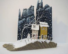 Driftwwod Cottages with Snowman and Winter background.
