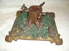 vintage christmas tree stand cast iron w look of a real tree trunk metal