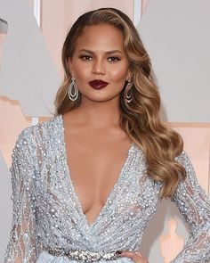 Stunning, as always! Chrissy Teigen really put her glam foot forward with incredibly sexy, wavy hair and totally trendy dark lips. Chrissy Teigen, 29, had jaws dragging on the floor -- or, better y...