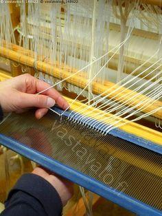 Dressing the loom.