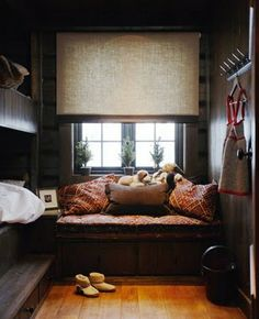 smart way to make a small room livable. bunks and window seat