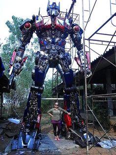 Gigantic Optimus Prime sculpture made from scrap metal.
