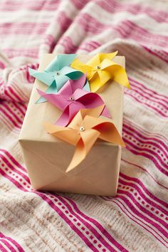 Simple gift wrap - craft paper & bright colored pin wheels