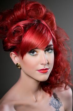 Beautiful redhead with a curly updo. love her medusa piercing. Also, fun orange pink ombre lips.