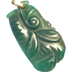 Vintage carved floral jade 1.75 x 1 inch pendant with solid gold bail