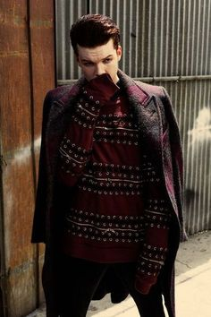 {Open: Ian} I had gotten sick, when it was cold I was cold then hot. Right now I was cold. So I was wearing layers, covering my mouth. I let out a cough, dropping my wrists to my sides.