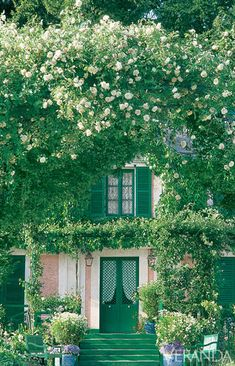 Monet's beautiful home at Giverny;he ordered a framework of trellises to be constructed,upon which various lovely rare,& traditional flowers could grow-including these magnificent climbing roses.
