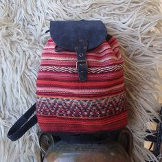 Black suede boho backpack with handwoven wool fibre