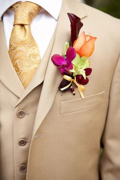 Groom: Fall Colors    The gold Brocade tie and vibrant boutonnire are a beautiful combination. Color as only we can wear it.